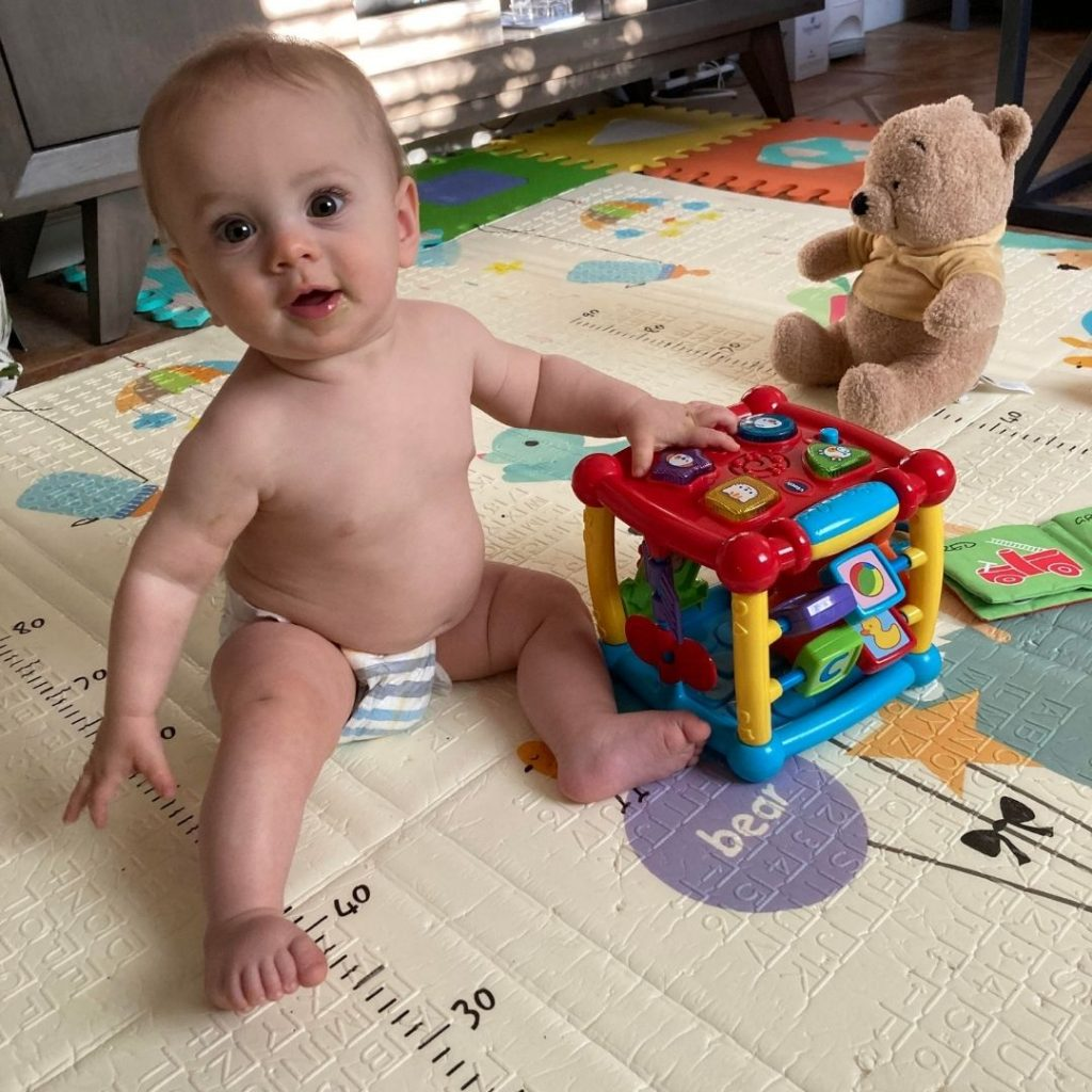 Leo playing in his diaper
