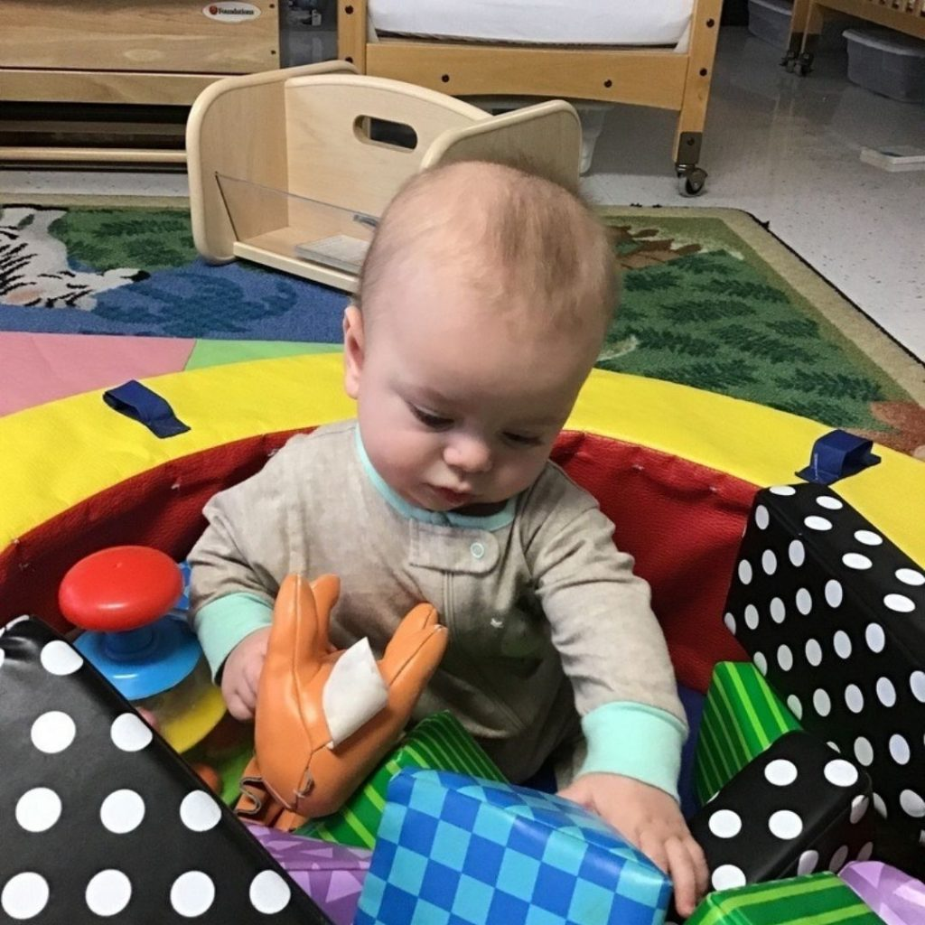 Leo playing with toys